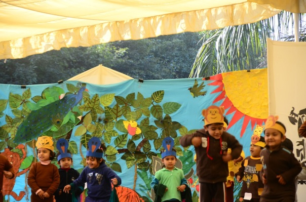 The littlest kids want to be animals! Check out the beautiful backdrop the children have helped create for their show. It changes with each group's presentation
