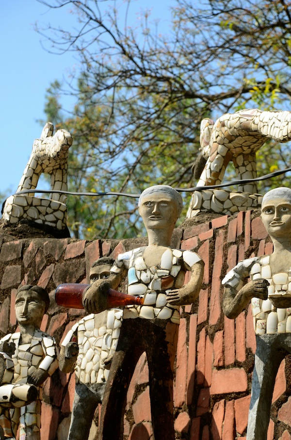 As you keave the Rock Garden, the familiar Nekchand-style sculptures say goodbye...check this one out enjoying his beer!