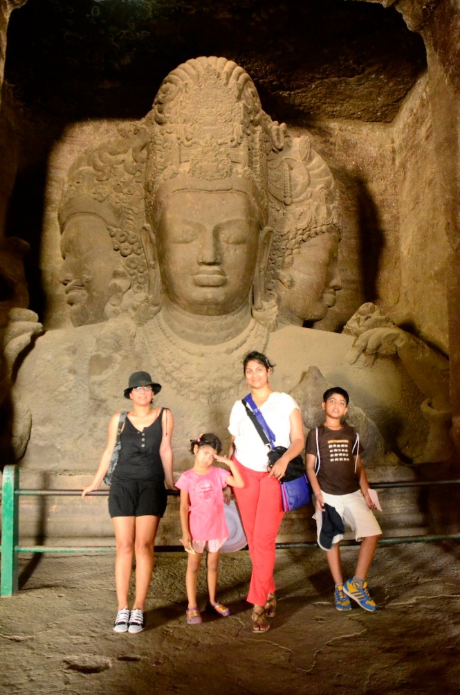 Standing before the magnificent trimurti