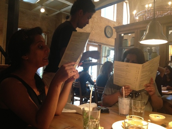 Noses inside the menu...Boy, were we hungry!