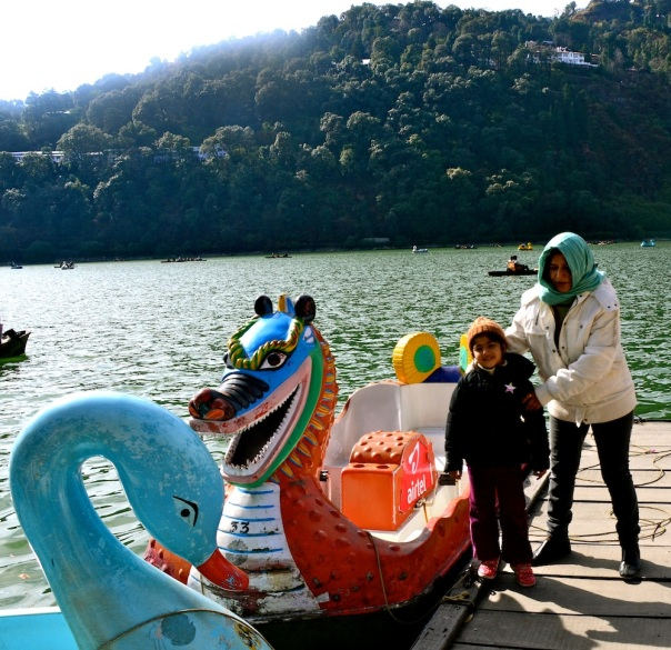 Nainital, Uttarakhans, Winter 2013. We are not forgivern for going in an ordinary boat. Aadyaa loves the bizarre dragon, grandmum loves Aadyaa and is holding her from jumping into the dragon!