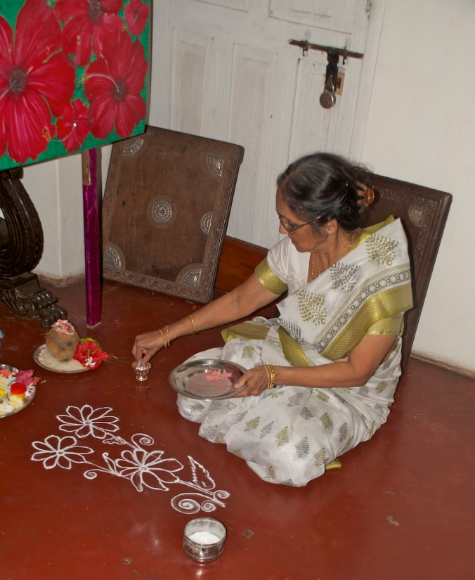 Rashmi kaki creating a small, lovely rangoli
