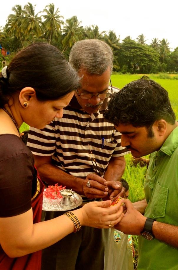Anuja, Nandan kaka and Rohit light an auspicious lamp