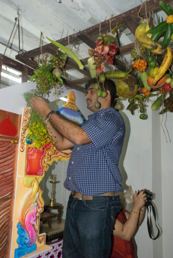 In 2011: My cousin Rohit putting up the matoli and a different decor for Ganpati in the background