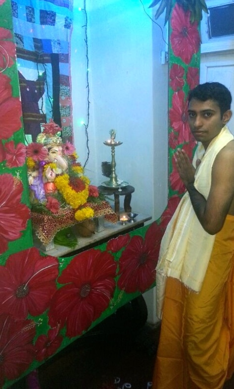My cousin Nimish in traditional attire paying his respects to the deity