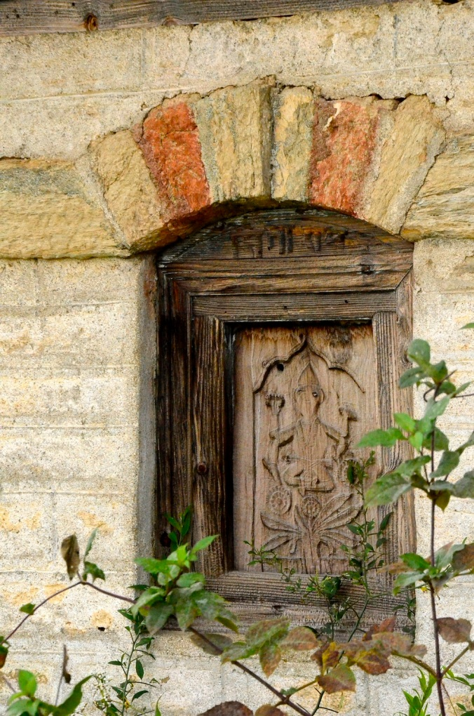 Carved door with typical colonial arch