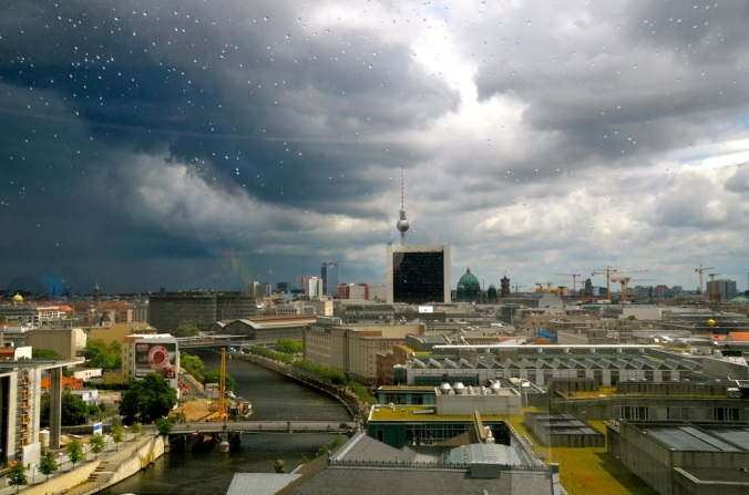As sen through the glass with the droplets of rain on it, Berlin looked ethereal