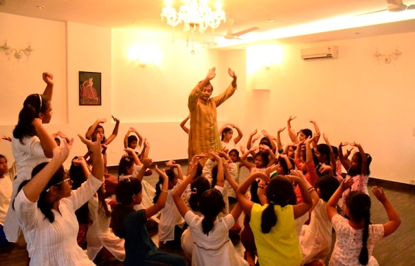Teaching the young children. Notice how he is the centre and they are all around him, absorbed completely in the act of learning