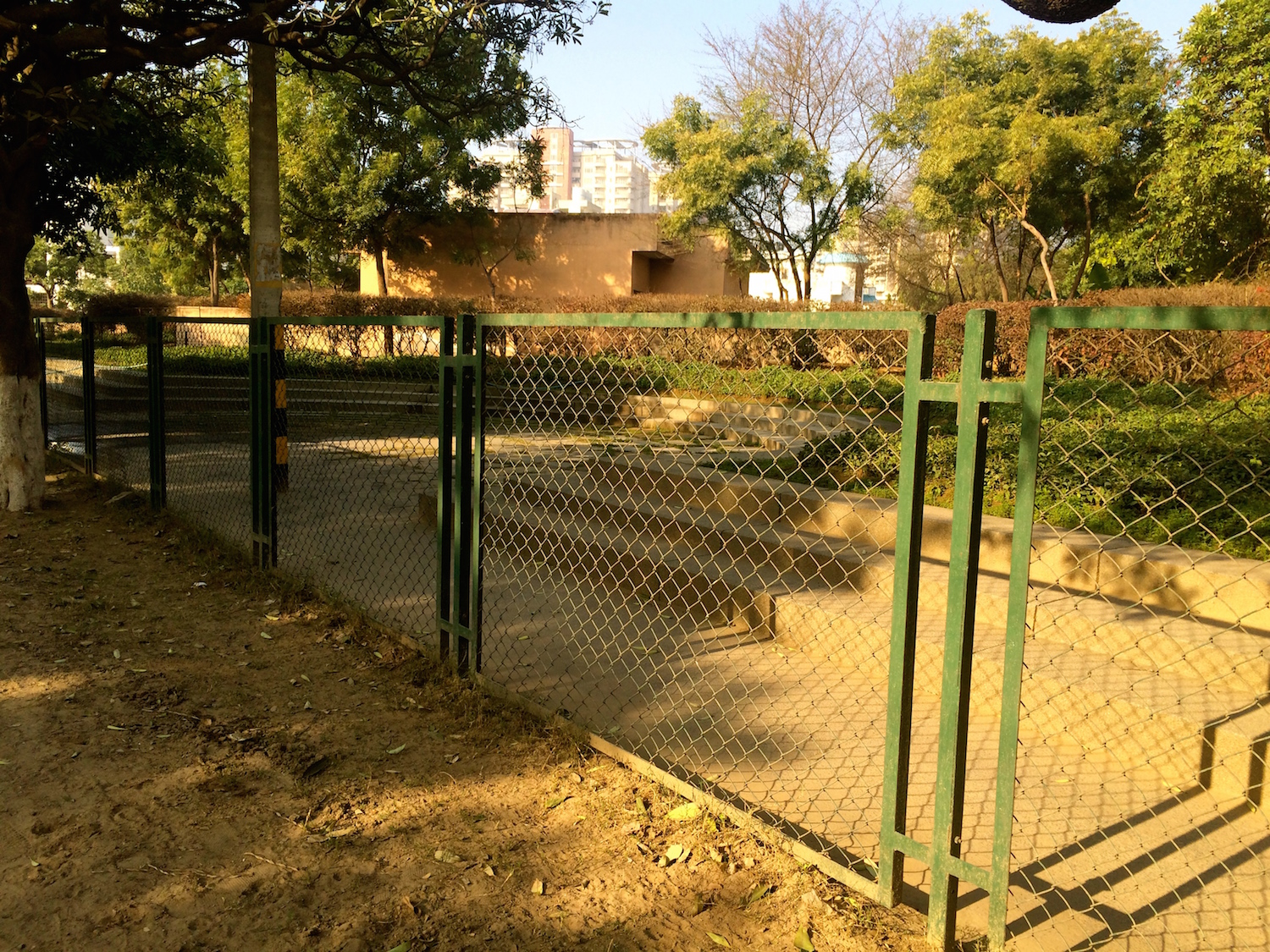 """Unfortunately much of this well maintained seating and green edge is cordoned off by ugly fencing, presumably to prevent """"unwanted"""" elements from entering and using these spaces"""