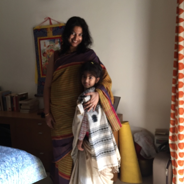 Day 2 ‪#‎100SareePact‬ A gift from my mother. She bought this lovely cotton at a small weaving Centre near Karaikudi, Tamil Nadu. Joining the saree craze is Aadyaa who was salivating over mums new black and white acquisition this morning; here she is draping the fabric over her night suit!