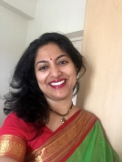 Day 9 ‪#‎100sareepact‬ A parrot green handloom with a bright red border, this saree has emerged after a decade thanks to the pact! This is the brightest colour I've worn in a while and am quite enjoying the feeling.
