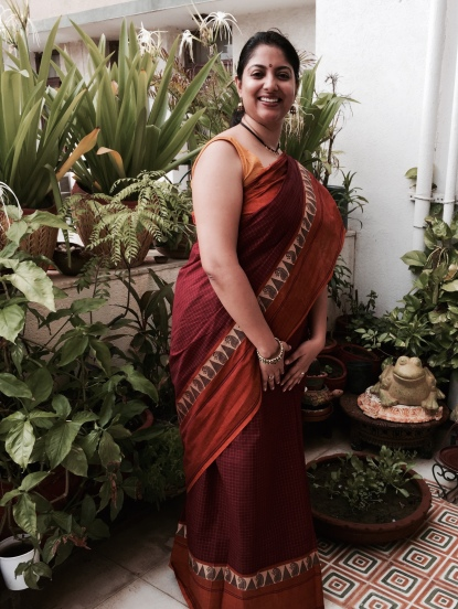 Day 34 #100sareepact Inspired by all the big border sarees posted by the lovely ladies doing the pact, I'm donning a classic kanchi cotton with a body of cheque and thread work border. A lovely earthy combination of turmeric and maroon, this is a saree that my Amamma has generously shared with me. Worn with traditional meenakari kairee neckpiece and jhumkis to complement the kairee pattern on the saree border.