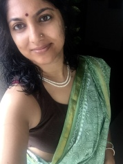 Day 45 ‪#‎100sareepact‬ On the occasion of Haryali Teej, I choose to wear another 'blessing' saree. This simple and elegant green cotton with a classic woven gold border was well worn by Rahul's Nani. Teaming it with a sleeveless brown blouse, pearls and the green bangles that are traditionally worn on teej.