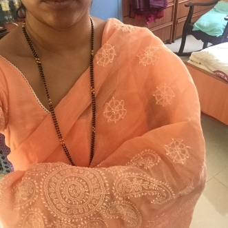 Day 65 #100sareepact I wore a saree today not because I'm doing the pact but because it's the default traditional attire in our family. A saree is what we wear for important occasions. Births, marriages and deaths. Today we said farewell to our beloved Ajjee, my paternal grandmother. She was Ajjee, Ayee, Mayee, Atee to hundreds. An inspirational figure who lived to be a hundred. Saying goodbye was hard indeed. Gathered together watching the rituals around death, a host of women in sarees (among a host of men in trousers and shirts who seem to have shunned traditional attire). Ordinary sarees. Floral prints, cottons, silks, synthetics. A predominance of whites and pastels as a mark of respect. Sarees picked without much thought. Or maybe not. Mine too a pastel peach cotton embroidered with chikankari (one I've worn very early in the pact)dumped into a suitcase in a hurry before catching a flight. A saree that's now embedded in a set of memories. A saree that is my companion in a journey to a place I've been to before and where I (and you) am destined to return to again and again. The altar of death where we stop and stand, watching our loved ones pass on, giving us their blessings.